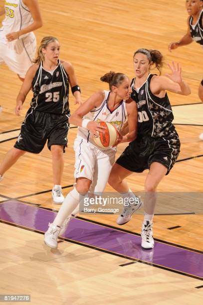 Diana Taurasi of the Phoenix Mercury drives against Ruth Riley of the San Antonio Silver Stars on July 15 at US Airways Center in Phoenix Arizona...