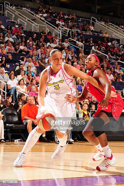 Diana Taurasi of the Phoenix Mercury drives against Sequoia Holmes of the Houston Comets on September 7 at US Airways Center in Phoenix Arizona NOTE...
