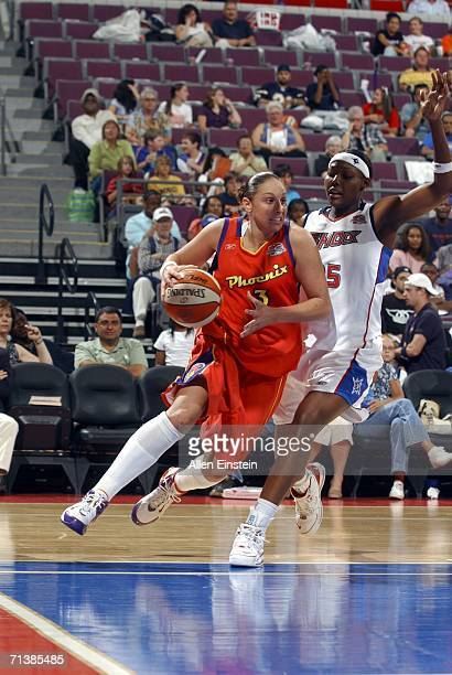 Diana Taurasi of the Phoenix Mercury drives around Cheryl Ford of the Detroit Shock on July 6 2006 at the Palace of Auburn Hills in Auburn Hills...