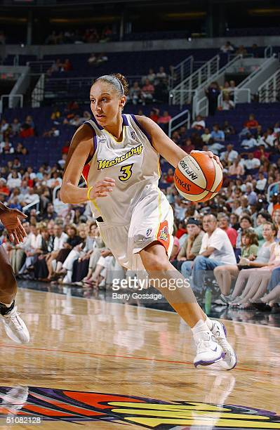 Diana Taurasi of the Phoenix Mercury drives during a game against the New York Liberty at America West Arena on June 24 2004 in Phoenix Arizona The...