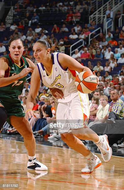 Diana Taurasi of the Phoenix Mercury drives past Adia Barnes of the Seattle Storm during a WNBA game played on September 4 2004 at America West Arena...