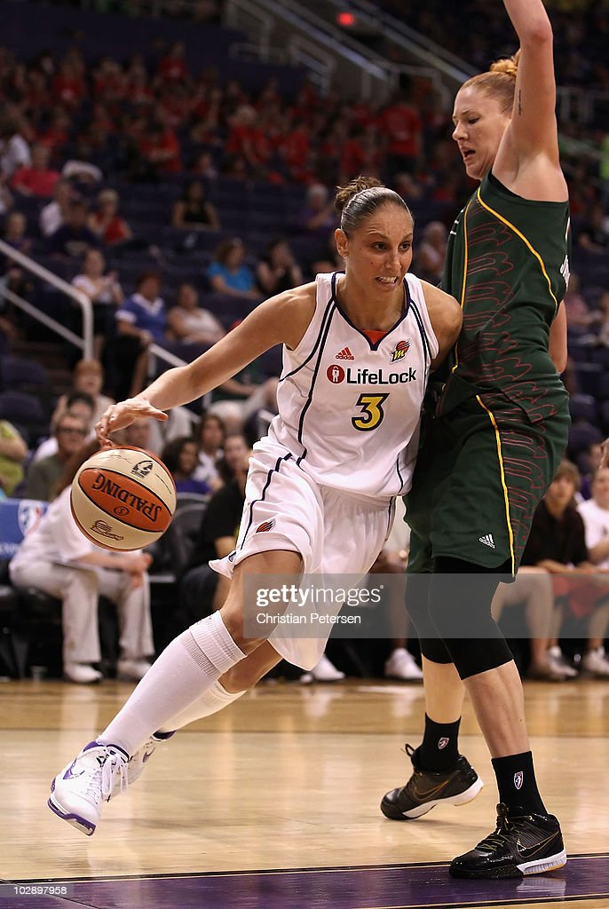 Diana Taurasi #3 of the Phoenix Mercury drives the ball against Lauren Jackson #15 of the Seattle Storm during the WNBA game at US Airways Center on July 14, 2010 in Phoenix, Arizona. The Storm defeated the Mercury 111-107 in triple overtime.