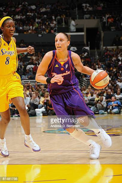 Diana Taurasi of the Phoenix Mercury drives the lane against DeLisha MiltonHarris of the Los Angeles Sparks on June 6 2008 at Staples Center in Los...