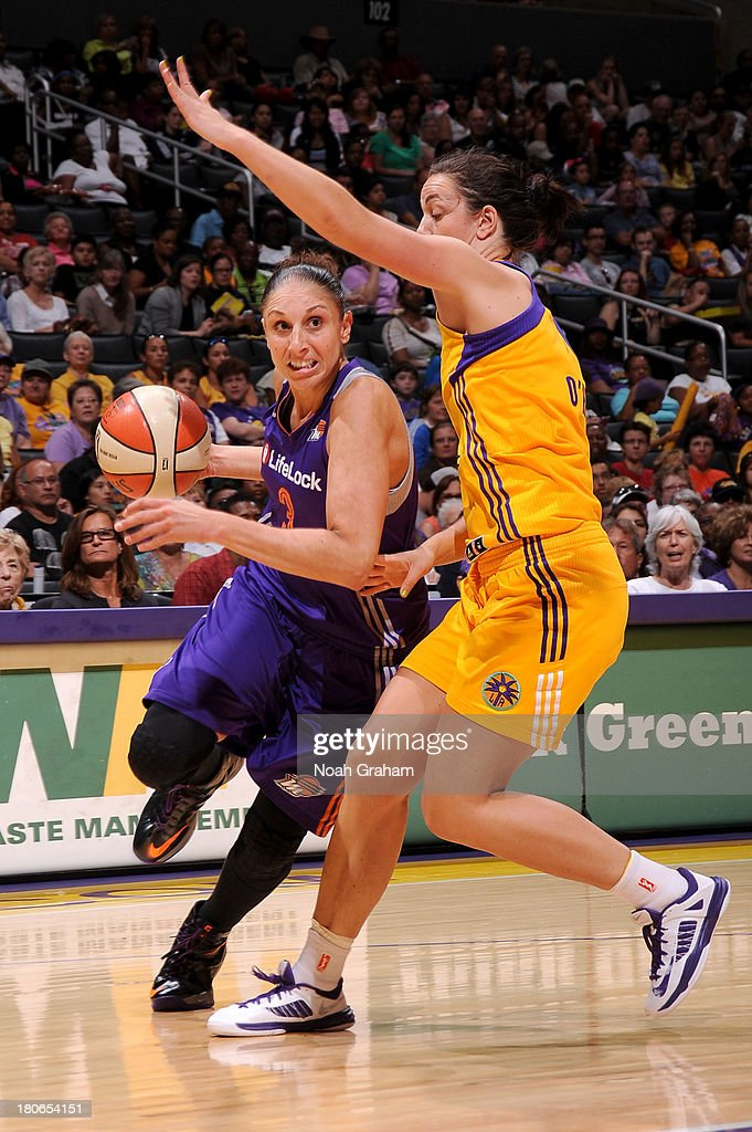 Diana Taurasi #3 of the Phoenix Mercury drives to the hoop against Jenna O'Hea #6 of the Los Angeles Sparks at Staples Center on September 15, 2013 in Los Angeles, California.