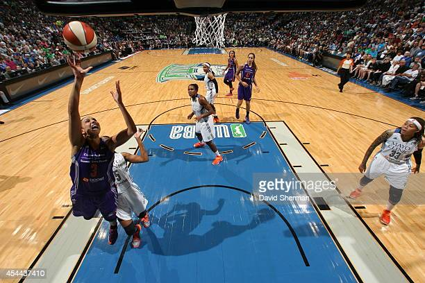 Diana Taurasi of the Phoenix Mercury goes for the shot against Tan White of the Minnesota Lynx during the WNBA Western Conference Finals Game 2 on...