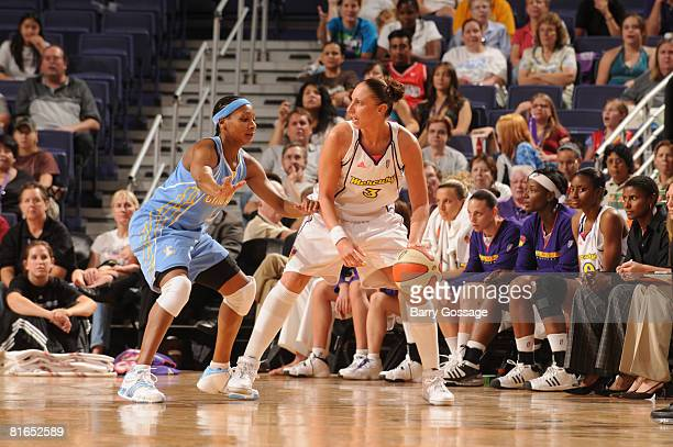 Diana Taurasi of the Phoenix Mercury handles the ball against Dominique Canty of the Chicago Sky on June 20 at U.S. Airways Center in Phoenix,...