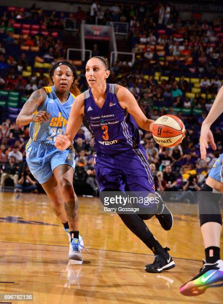 Diana Taurasi of the Phoenix Mercury handles the ball against Cappie Pondexter of the Chicago Sky on June 16 2017 at Talking Stick Resort Arena in...