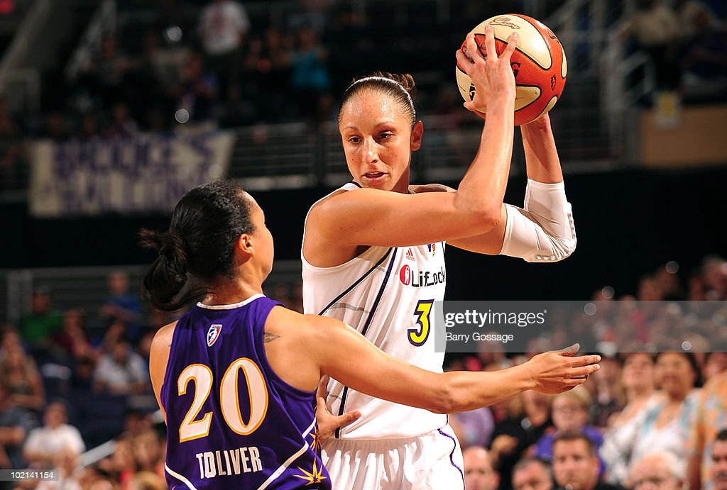 Diana Taurasi #3 of the Phoenix Mercury handles the ball against Kristi Toliver #20 of the Los Angeles Sparks during the WNBA game on June 4, 2010 at U.S. Airways Center in Phoenix, Arizona. The Mercury won 90-89.