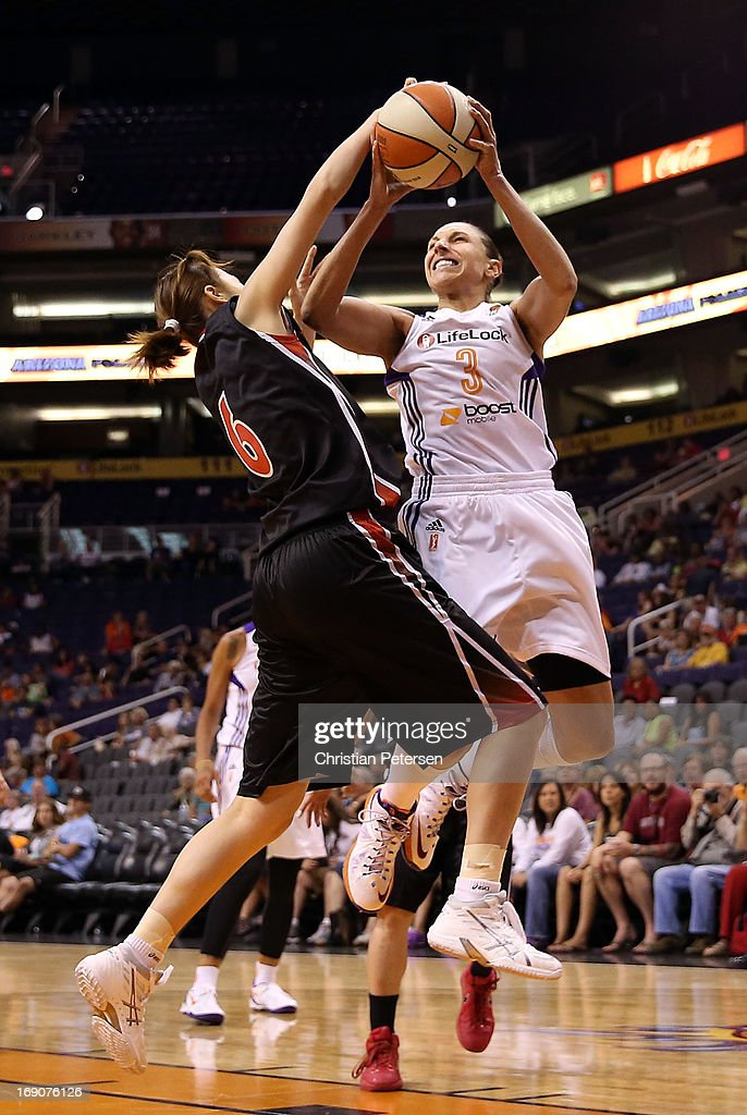 Diana Taurasi #3 of the Phoenix Mercury is fouled as she attempts a shot against Kana Motoyama #6 of Japan during the preseason WNBA game at US Airways Center on May 19, 2013 in Phoenix, Arizona.