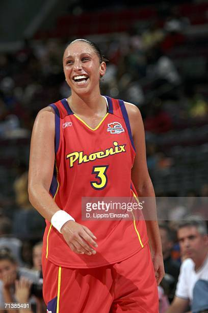 Diana Taurasi of the Phoenix Mercury laughs during her game against the Detroit Shock on July 6 2006 at the Palace of Auburn Hills in Auburn Hills...