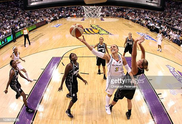 Diana Taurasi of the Phoenix Mercury lays up a shot past Jayne Appel of the San Antonio Silver Stars in Game One of the Western Conference Semifinals...