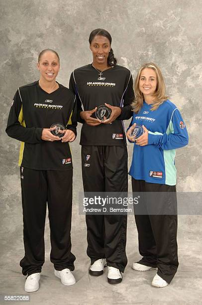 Diana Taurasi of the Phoenix Mercury Lisa Leslie of the Los Angeles Sparks and Becky Hammon of the New York Liberty pose together after being named...
