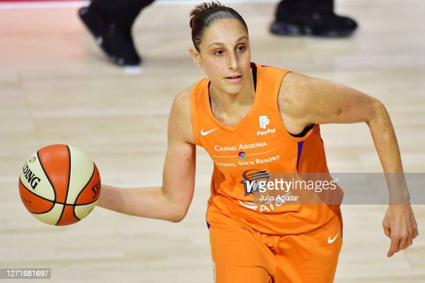 Diana Taurasi of the Phoenix Mercury looks to pass the ball during the first half against the Connecticut Sun at Feld Entertainment Center on...