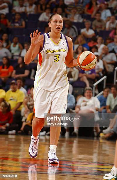 Diana Taurasi of the Phoenix Mercury moves the ball against the Seattle Storm during the WNBA game on June 2 2005 at America West Arena in Phoenix...
