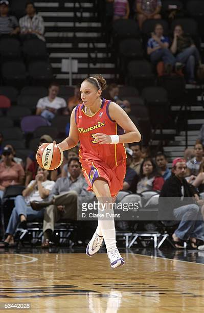 Diana Taurasi of the Phoenix Mercury moves the ball against the San Antonio Silver Stars during the WNBA game on July 23 2005 at SBC Center in San...