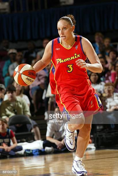 Diana Taurasi of the Phoenix Mercury moves the ball downcourt against the New York Liberty on June 18 2005 at Madison Square Garden in New York City...
