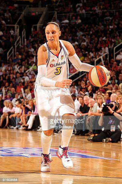 Diana Taurasi of the Phoenix Mercury moves the ball up court in Game Five of the WNBA Finals against the Indiana Fever at US Airways Center on...