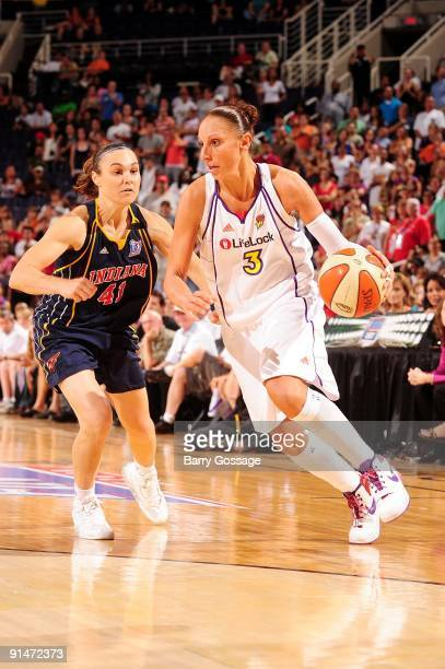Diana Taurasi of the Phoenix Mercury moves the ball up court past Tully Bevilaqua of the Indiana Fever in Game one of the WNBA Finals during the 2009...