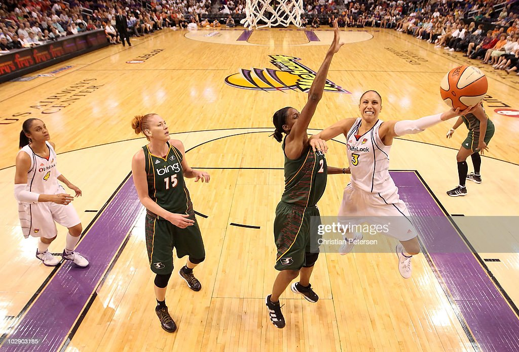 Diana Taurasi #3 of the Phoenix Mercury puts up a shot past Swin Cash #2 of the Seattle Storm during the WNBA game at US Airways Center on July 14, 2010 in Phoenix, Arizona. The Storm defeated the Mercury 111-107 in triple overtime.