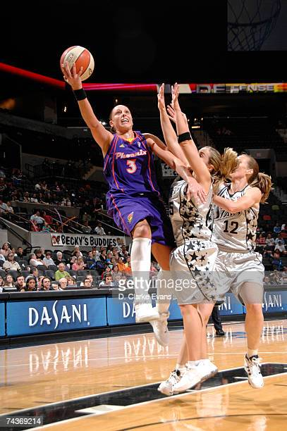 Diana Taurasi of the Phoenix Mercury shoots against Becky Hammon of the San Antonio Silver Stars during the game at the ATT Center on May 31 2007 in...