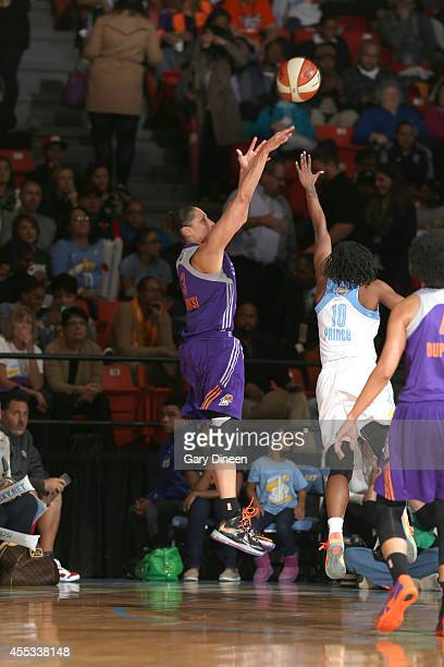 Diana Taurasi of the Phoenix Mercury shoots against Epiphanny Prince of the Chicago Sky in Game Three of the 2014 WNBA Finals on September 12 2014 at...