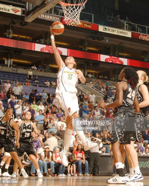 Diana Taurasi of the Phoenix Mercury shoots against Morernike Atunrase of the San Antonio Silver Stars on July 15 at US Airways Center in Phoenix...