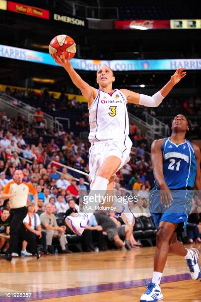 Diana Taurasi of the Phoenix Mercury shoots against Nicky Anosike of the Minnesota Lynx in an WNBA game played on June 10 2010 at US Airways Center...