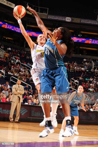Diana Taurasi of the Phoenix Mercury shoots against Nicky Anosike of the Minnesota Lynx at US Airways Center September 3 2008 in Phoenix Arizona NOTE...