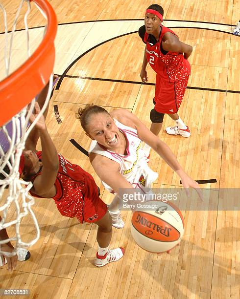 Diana Taurasi of the Phoenix Mercury shoots against Sequoia Holmes of the Houston Comets on September 7 at US Airways Center in Phoenix Arizona NOTE...