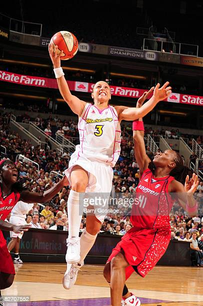 Diana Taurasi of the Phoenix Mercury shoots against Shannon Johnson of the Houston Comets on September 7 at US Airways Center in Phoenix Arizona NOTE...