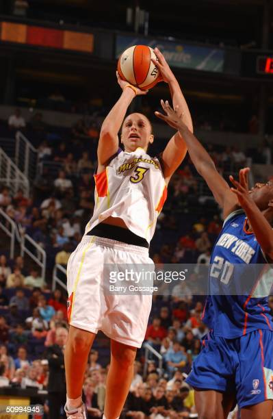 Diana Taurasi of the Phoenix Mercury shoots against the New York Liberty during a WNBA game on June 24 2004 at America West Arena in Phoenix Arizona...
