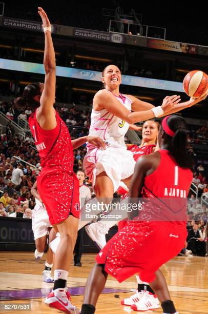 Diana Taurasi of the Phoenix Mercury shoots against Tina Thompson of the Houston Comets on September 7 2008 at US Airways Center in Phoenix Arizona...
