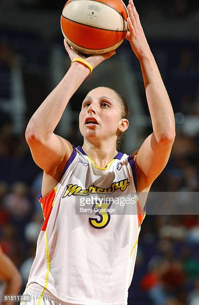 Diana Taurasi of the Phoenix Mercury shoots during a WNBA game against the Seattle Storm on September 4 2004 at America West Arena in Phoenix Arizona...