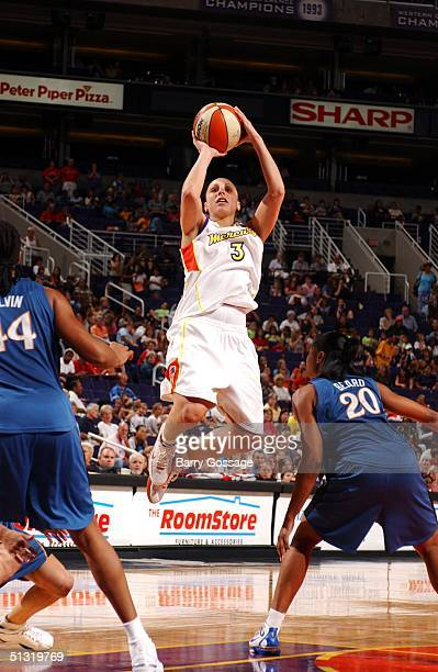 Diana Taurasi of the Phoenix Mercury shoots in WNBA action against the Washington Mystics September 17 2004 at America West Arena in Phoenix Arizona...