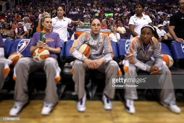 Diana Taurasi of the Phoenix Mercury sits on the bench with Penny Taylor and Temeka Johnson before the WNBA game against the Los Angeles Sparks at US...