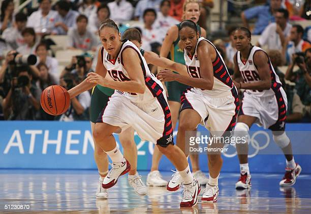 LR0 Diana Taurasi of the United States drives the ball down court with teammates Tina Thompson Tamika Catchings against Australia during the women's...