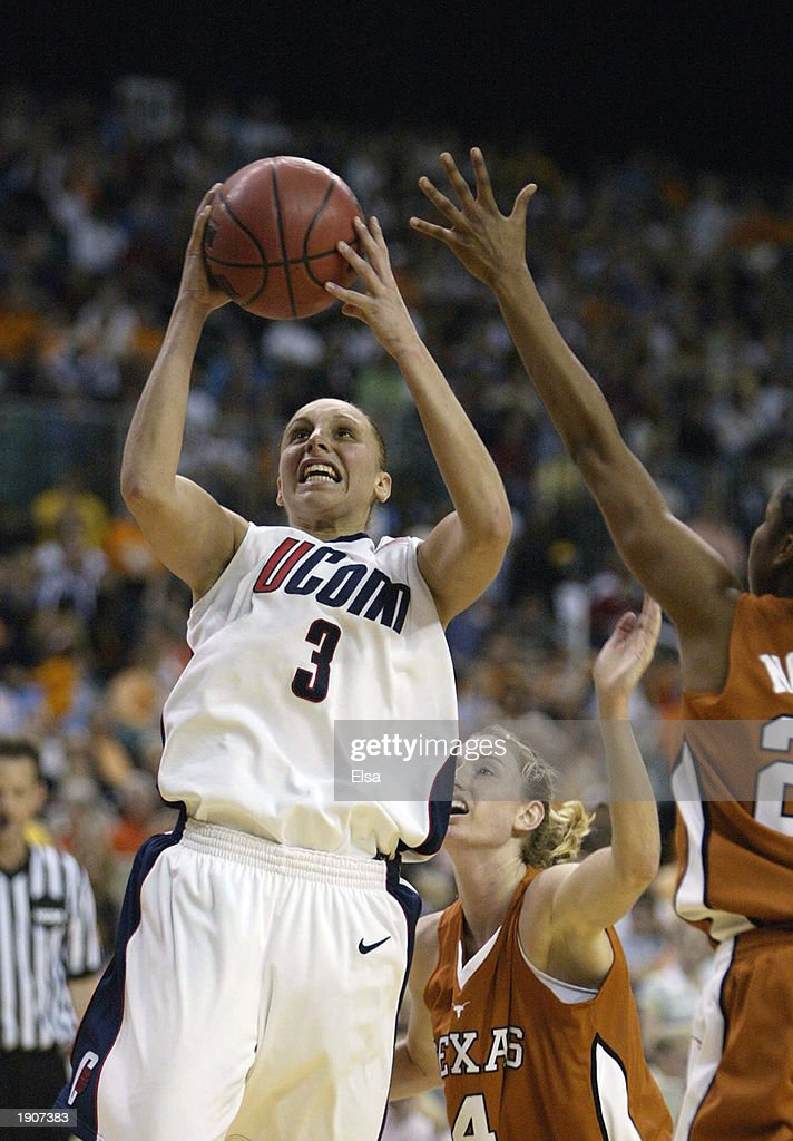 Diana Taurasi #3 of the University of Connecticut Huskies shoots against the University of Texas at Austin Longhorns during the NCAA Women's Final Four game at the Georgia Dome on April 6, 2003 in Atlanta, Georgia. Connecticut defeated Texas 71-69.