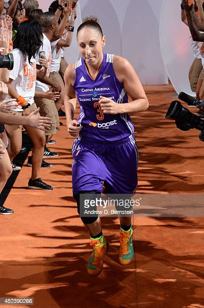 Diana Taurasi of the Western Conference AllStars is introduced before the 2014 Boost Mobile WNBA AllStar Game on July 19 2014 at US Airways Center in...