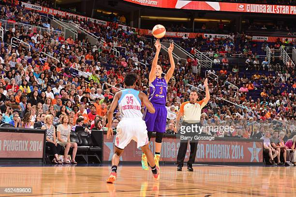 Diana Taurasi of the Western Conference AllStars shoots against Angel McCoughtry of the Eastern Conference AllStars during the 2014 Boost Mobile WNBA...