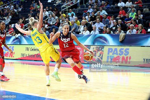 Diana Taurasi of the Women's Senior US National Team drives against Erin Phillips of Australia during the semifinal round of the 2014 FIBA World...