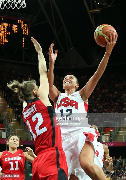 Diana Taurasi of United States drives to the basket against Lizanne Murphy of Canada during the Women's Basketball quaterfinal on Day 11 of the...