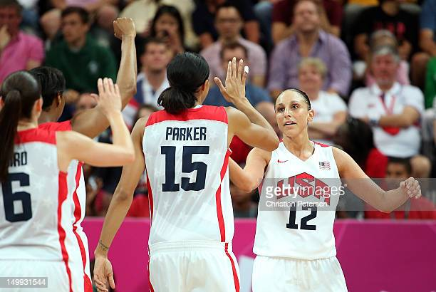 Diana Taurasi of United States highfives Candace Parker after scoring against Canada during the Women's Basketball quaterfinal on Day 11 of the...