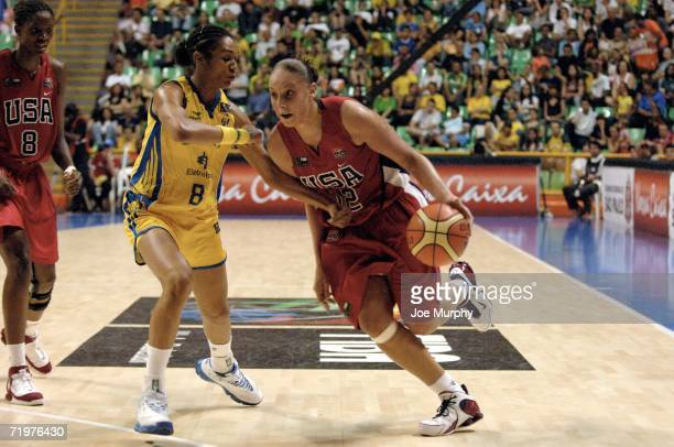 Diana Taurasi of USA drives past Iziane Marques of Brazil during the bronze medal game between USA and Brazil during the 2006 FIBA World Championship...