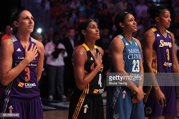 Diana Taurasi Skylar Diggins Maya Moore and Candace Parker of the Western Conference AllStars stand for the National Anthem during the 2014 Boost...