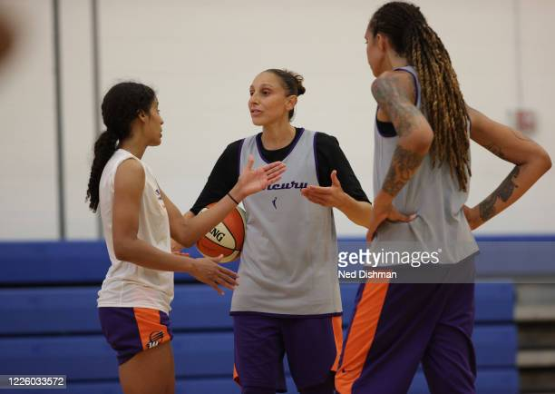 Diana Taurasi talks with Skylar Diggins-Smith and Brittney Griner of the Phoenix Mercury during practice at IMG Academy on July 10, 2020 in...