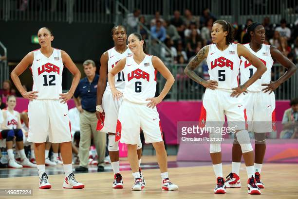 Diana Taurasi Tamika Catchings Sue Bird Seimone Augustus and Tina Charles of the United States stand together on the court in the Women's Basketball...