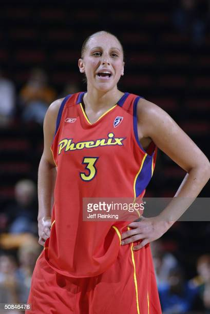 Diana Taurusi of the Phoenix Mercury yells to her teammates during a preseaon game May 16 2004 at Key Arena in Seattle Washington NOTE TO USER User...
