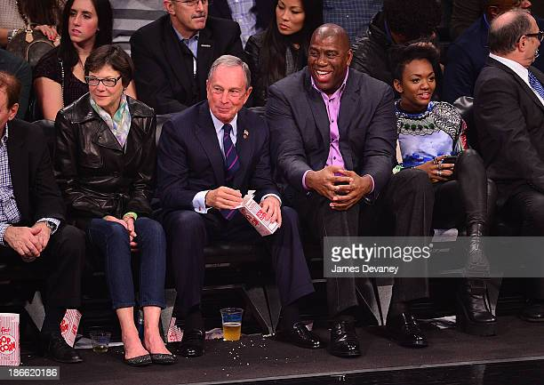 Diana Taylor Mayor Michael Bloomberg Magic Johnson and daughter Elisa attend the Miami Heat vs Brooklyn Nets game at Barclays Center on November 1...