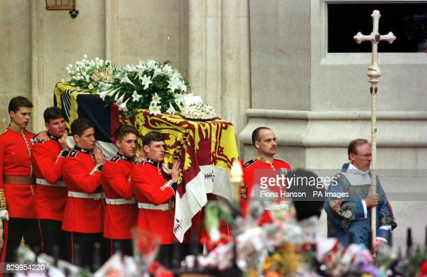 Diana the Princess of Wales' coffin is carried out of Westminster Abbey by pallbearers from the Welsh Guards following her funeral service