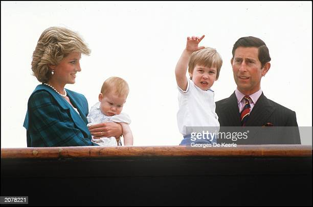 Diana the Princess of Wales holds her son Harry whilst looking at Prince William held by his father Prince Charles on May 5 1985 in Venice Italy...